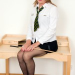 Tgirl in uniform spreads her legs